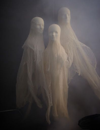 DIY ghosts: Model heads and cheese cloth can be purchased at most major craft stores. Simply stretch the cheese cloth over the heads, using glue to hold them down.
