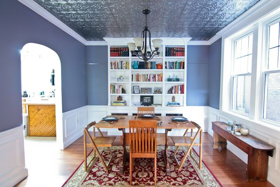 A completely customized job!  Hand built bookcases designed to fit over a radiator, hidden doors on each side of the bookcase, and a brand new tin ceiling.