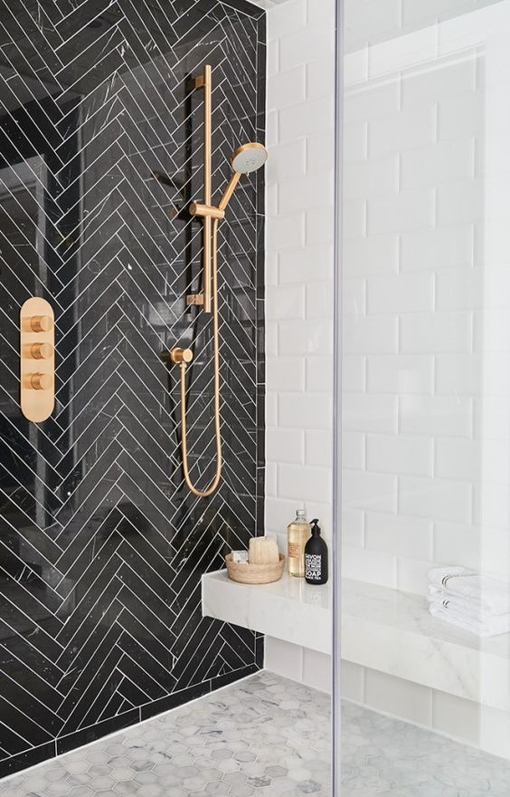 Black Marble Herringbone shower with gold fixtures