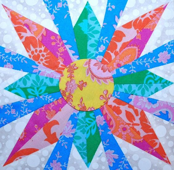 Pretty Amy Butler fabric. A different kind of dresden quilt block.