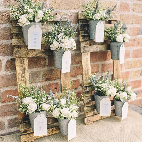 rustic wedding table plan with flower pots by the wedding of my dreams | notonthehighstreet.com