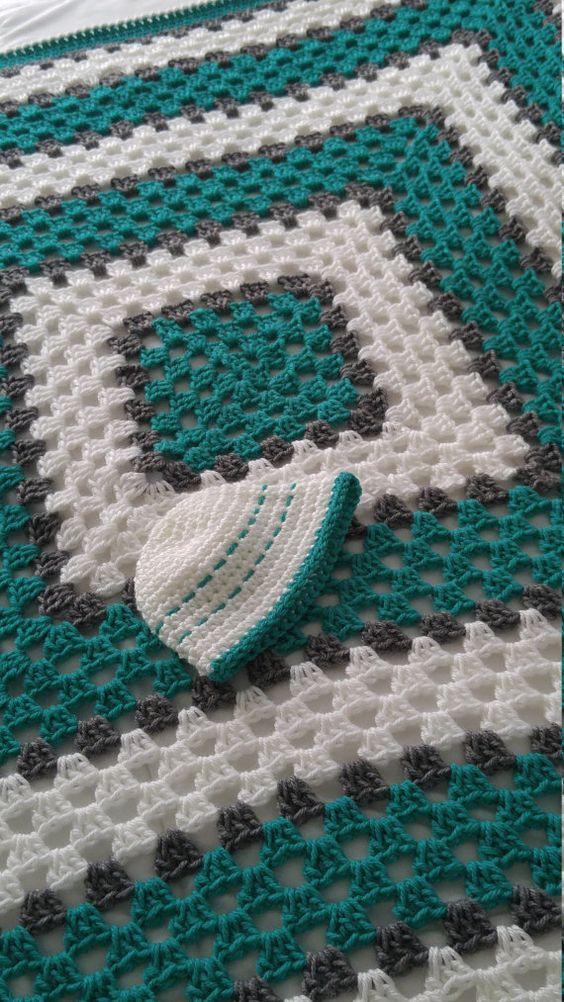 Eine schöne Oma quadratische Decke in weiche Baby Garn gemacht ist sicher, sanft…