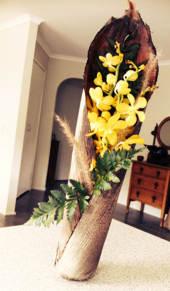 Yellow orchid and leather fern