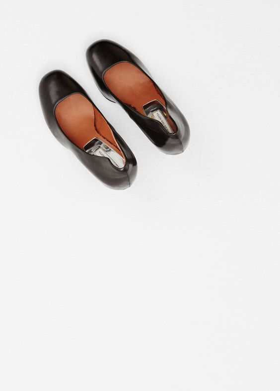 """Leather heel in black with rounded toe. 3.5"""" heel in black leather with heel plate in black. Sole in black leather. Slips on. Dust bag included.  Dries Van Noten"""