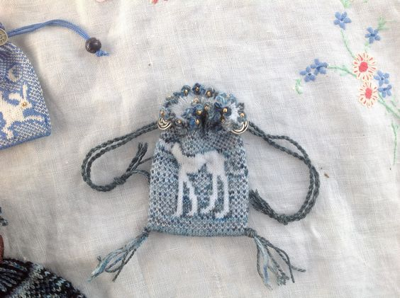 Greyhound amulet/treat bag knitted in fine wool on tiny needles.