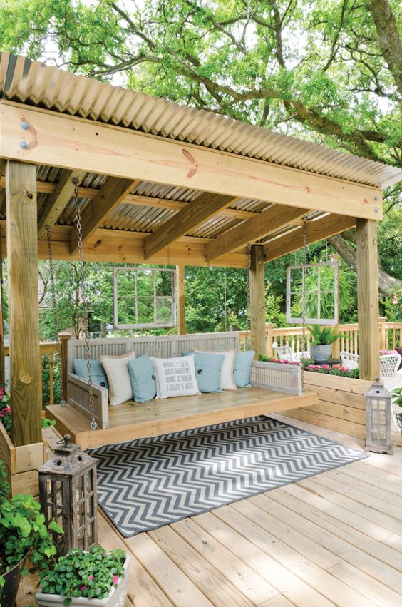 like the mix of old and new, tin roof, wouldnt do the swing tho, just giant cushy bench: