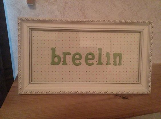 Picture frame, Scrapbook paper  with Painted letters. Made this for my best friends daughters nursery :)