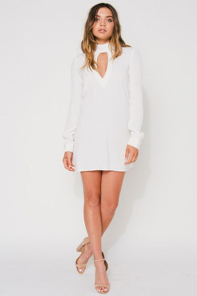 Long sleeve mini dress with a sexy keyhole in thefront and back. The perfect date night dress to pair with wedges or boots. more colors/prints are available m