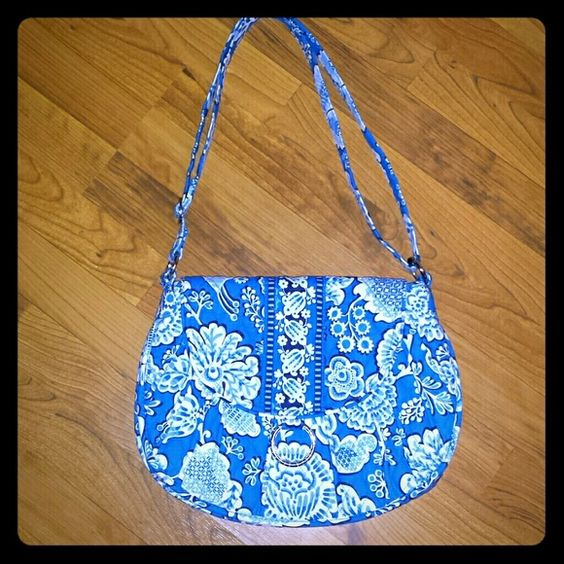 Vera Bradley Sadle Bag Never Used the bag because when I received it in the mail from Vera Bradley I realized it was too young for me. Medium size Adorable bag that has many inside pockets to put your valuables and also a Large zippered pocket. Purse can also be used as a crossbody bag. Outside flap has a magnetic closure. Vera Bradley Bags Shoulder Bags