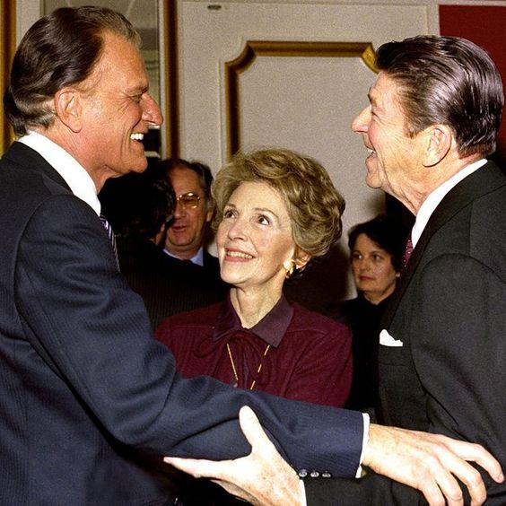 Billy Graham and Ronald Reagan catch up as Nancy Reagan looks on. These are some of my American heroes and it's so powerful to see them together. #GodBlessAmerica