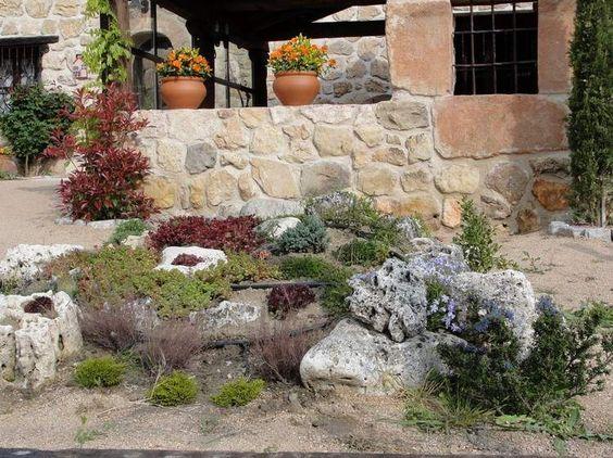 ziergraeser sandstein feuerstelle anlegen pflanzen steingarten anlegen