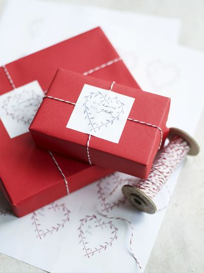 red gift wrapping with baker's twine and stickers: