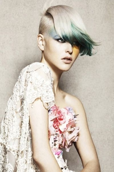 Fun and Edgy Bleached Blonde Pixie Cut with A Colored Fringe