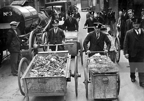 25th June 1940, Council workers in Holborn, London collect barrow loads of food waste to feed to pigs