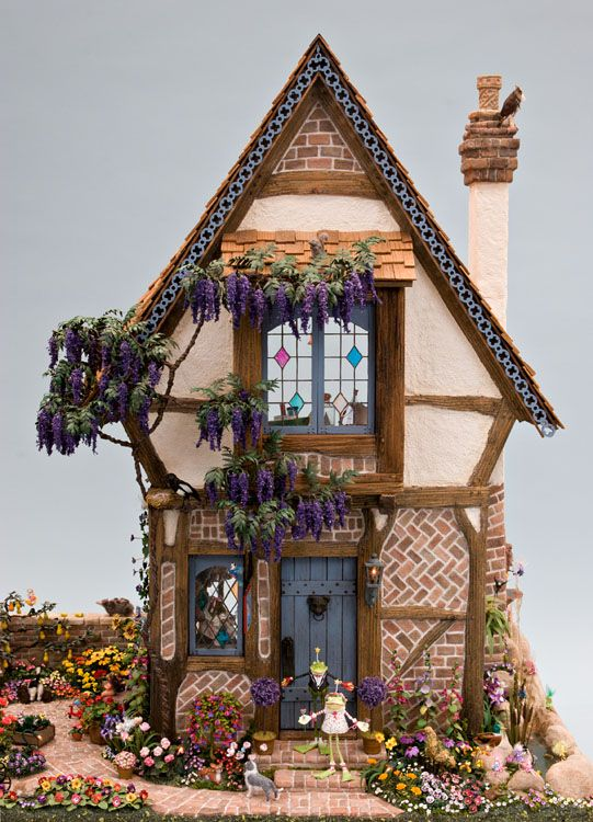 """This week's exhibit is from the 2007 Good Sam Show. Michael Puff took a workshop from Rik Pierce, Frogmorton Studios, to build the Three Bears Cottage. Michael made the structure into """"McTavish Toy Shoppe and Fairy Garden."""" He also incorporated a Fairy Garden. For landscaping, he bought florals from fine artisans at the Good Sam Show or used kits. His mother, Martha Puff, furnished the interior with her collection of miniature toys."""