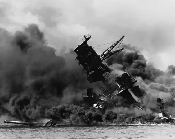Pearl Harbor on December 7th, 1941. It was this attack that caused the United States to join WWII. This picture in particular is a picture of the USS Arizona sinking, killing 1,177 men aboard.