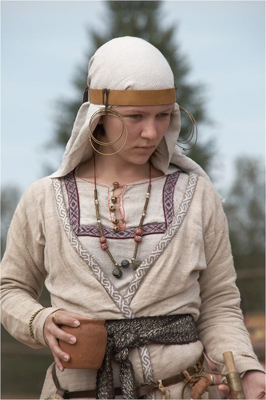 Portrait of a Russian girl in medieval costume. Fashion of the 12th century. Modern replica.