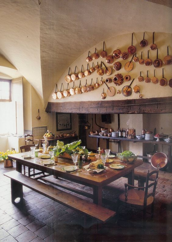 Rustic European farmhouse kitchen with copper pots and farm table. 40 Beautiful European Country Kitchens. #kitchen #european #farmhouse #oldworld #copper