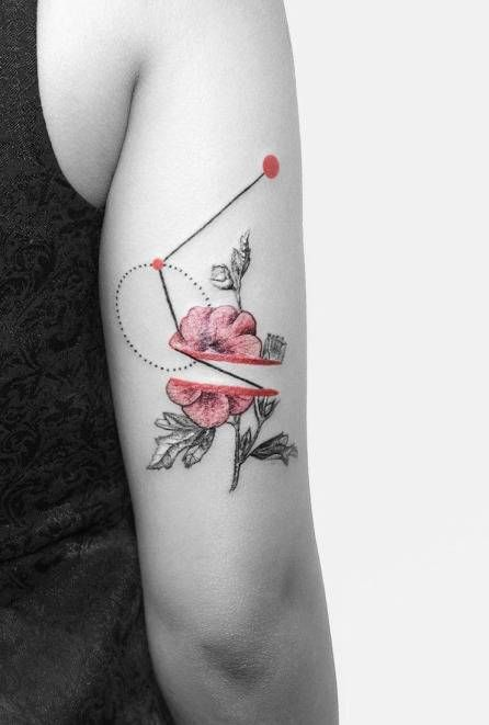 Graphic style tattoo on the back of the right arm.