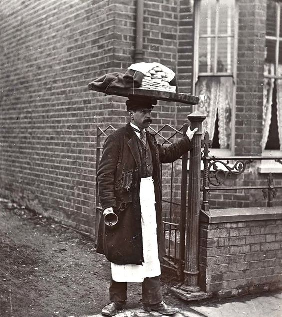 """A Muffin Man, c.1910, London~ Victorian/Edwardian households had many fresh foods delivered; muffins would be delivered door-to-door.""""Have you seen the muffin man, the muffin man.Have you seen the muffin man who lives down Drury Lane."""" """"The Muffin Man"""" is a traditional nursery rhyme & children's song.Drury Lane is a thoroughfare in Westminster"""