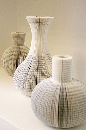 "book vases. Totally neat. I just need to get over my ""don't ruin a book"" thing...."