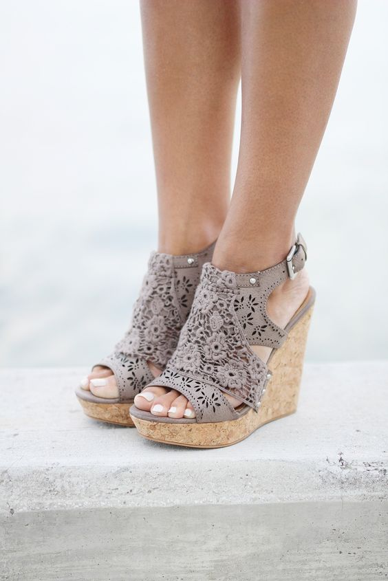 "Meet your new bestie, Candace! These wedges are simply gorgeous, with a laser-cut pattern and feminine lace overlay, all stacked on top of a 4 1/2"" wedge with 1 1/4"" platform. The both of you are sure"