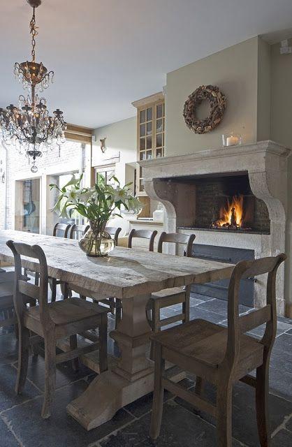 Rustic table, fabulous fireplace. 12 European Farmhouse Rustic Decorating Ideas.