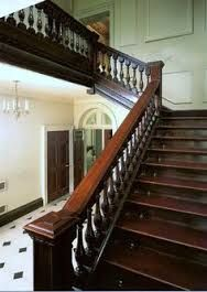 Mahogany Staircase with Iron Balusters and wainscoting ...