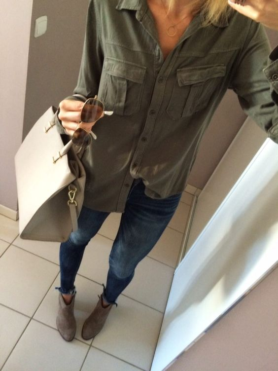 Fall fashion inspiration: ankle booties, olive green utility shirt with a half tuck, fray hem skinny jeans, raybans, and structured satchel | 6 Super Cute Ways to Style a Utility Shirt for Fall | Fall Fashion Inspiration