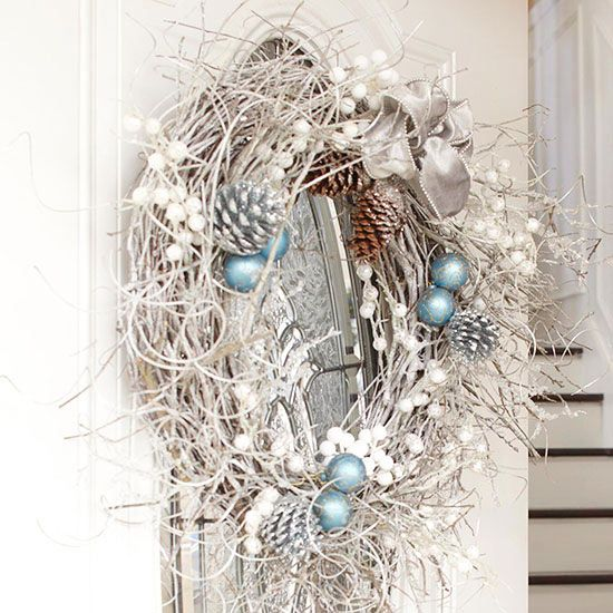 Spray-Painted Holiday Wreath - inexpensive can of spray paint, a grapevine wreath, pine cones, twigs and shimmery accents, finish with a ribbon bow - DIY Winter Decor: