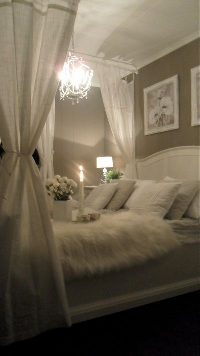 OMG..I was meant to sleep like this!! A chandelier over the bed ...
