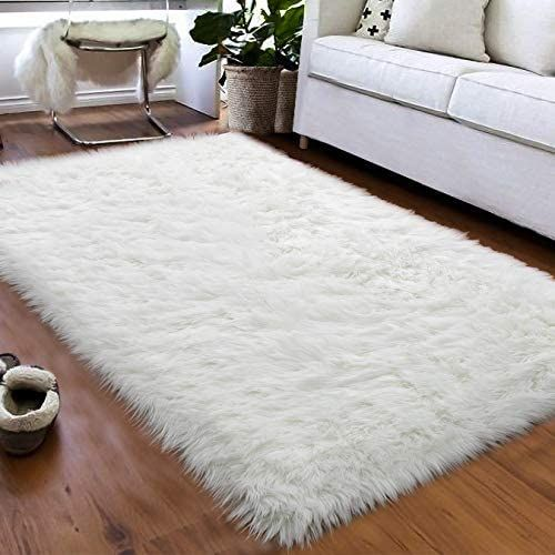 Living Space Rugs Medium Pile Woven Rugs Work Well For Many Rooms Including Medium To High Traffi In 2020 Faux Fur Area Rug White Area Rug Bedroom Faux Sheepskin Rug