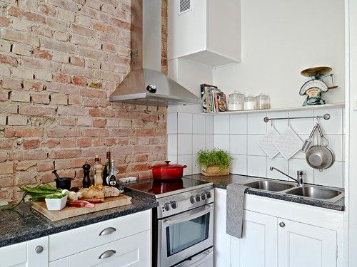 Lovely brick wall in kitchen.