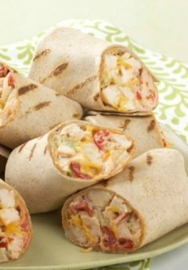 Mexican Grilled Chicken Wrap — These super easy grilled chicken wraps with coleslaw, cheese, and tomatoes deliver warm Mexican flavors without a lot of prep time.