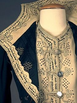 lady's military-style black and cream wool felt bodice - Close up