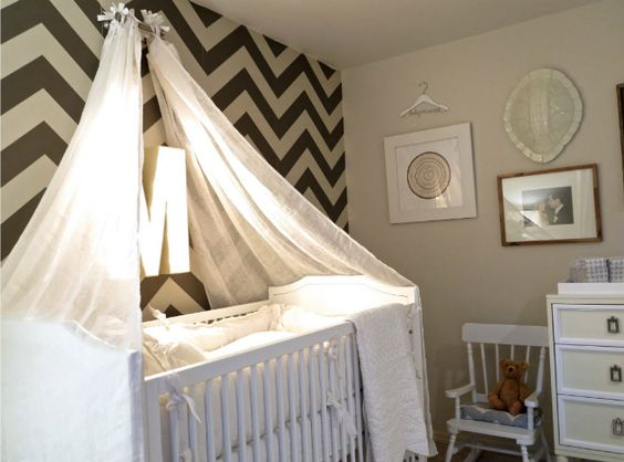 This black and white chevron accent wall makes such a statement! {Click to see more of Jason and Molly Mesnick's Daughter's Nursery}