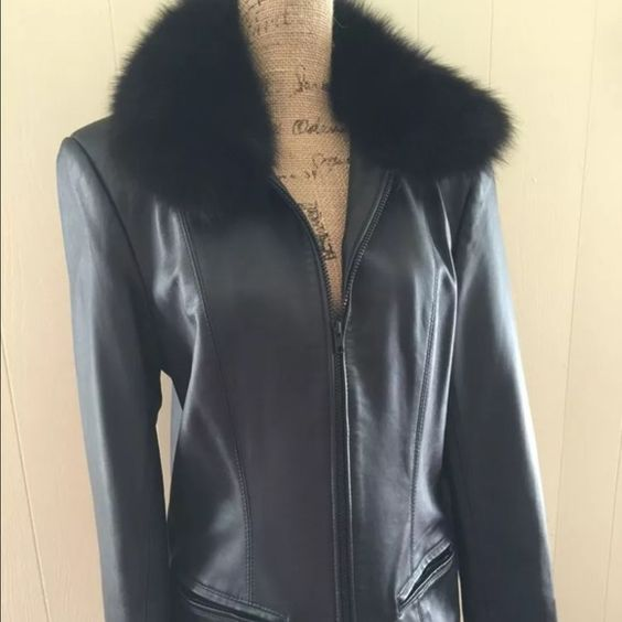"""Henig Furs leather and fox fur black jacket Gorgeous soft lamb skin Leather and Fox Fur Jacket with removable collar. Size medium.  Bought for $800 dollars. Never been able to wear living in the south.  Jacket zipped, bust measures 19"""" Length is 25"""".  Questions welcome  Smoke free pet free home. Henig Leather  Jackets & Coats Blazers"""