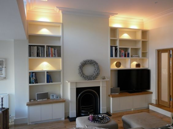 alcove storage with tv on shelf different width alcoves like ours perhaps we should have the tv on the bigger side like the shelves and the wooden tops alcove lighting ideas