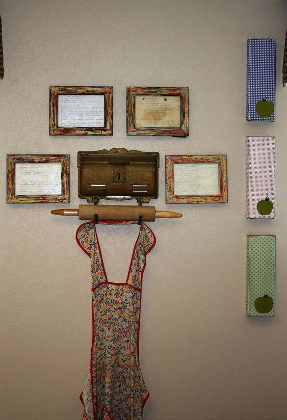 One of my kitchen walls.  Framed handwritten recipes from both our grandmothers, my great grandmothers apron, his great aunts old mailbox (which I plan on keeping recipe cards in.