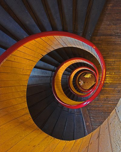 winding staircase, red handrail