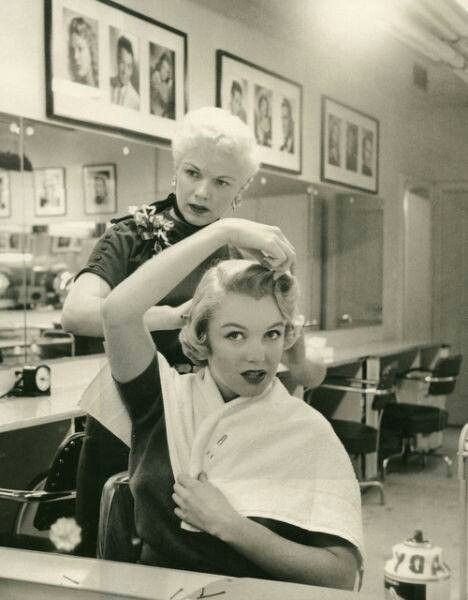 blonde doing the hair of another blonde