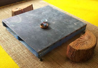 Put hardboard on top of a pallet to make a chalk board - could also stand upright to make a vertical board.