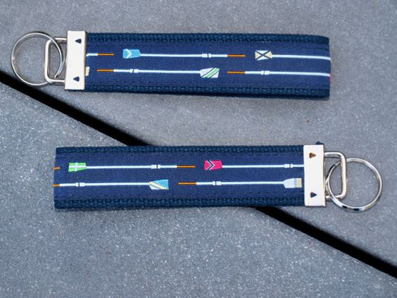 Key wristlet with multi colored Crew Oar Blades. Custom Jacquard Ribbon on canvas webbing.  Multi colored Crew Blades on navy blue fabric on a 1.25 inch