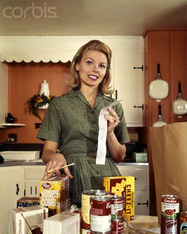 corbis images 1960's | 1960s Young Housewife While Checking Grocery Shopping Receipt  ...
