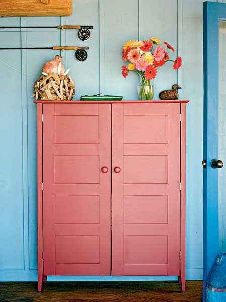Love the coral and blue! Need a cabinet/hutch like this