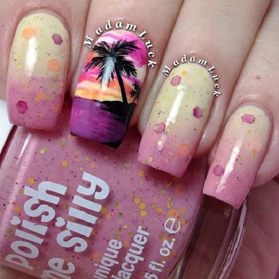 Pink themed Palm Tree Nail Art design. Different levels of the color pink are used in the nail art with the black silhouette of the palm trees used as the darkest shade. T looks well coordinated and cute when combined with the elements of the design.