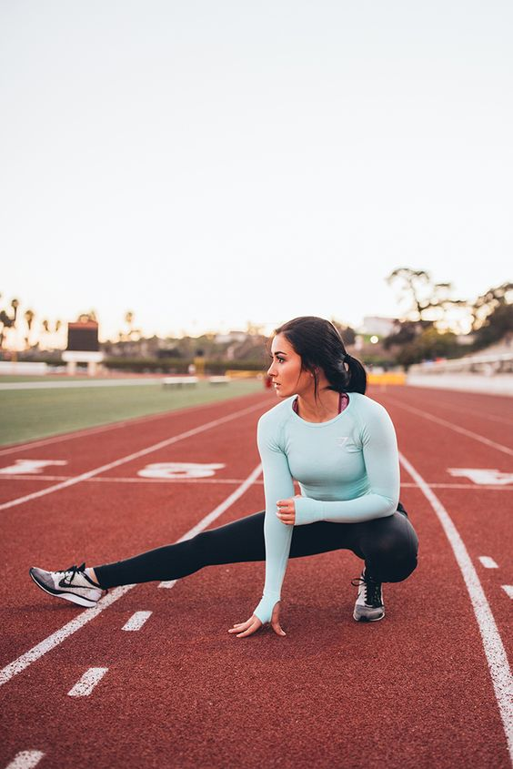 Hit the ground running. Ally Stone wearing the Sculpture leggings in black with the Seamless mint green top