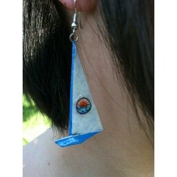 light blue sailboats with circle emblem of a sun setting over waves.-$15