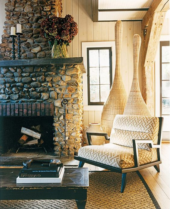 mixed materials: stone, brick, hardwood.  and mixed styles: vintage, casual, mid-century, traditional.  = winner.