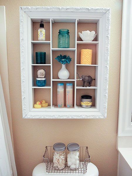 After finding this ornate frame at a thrift store, Jamielyn, of the blog I Heart Naptime, upcycled it as a bathroom shelf. She coated it with white spray paint to match the space's color scheme.
